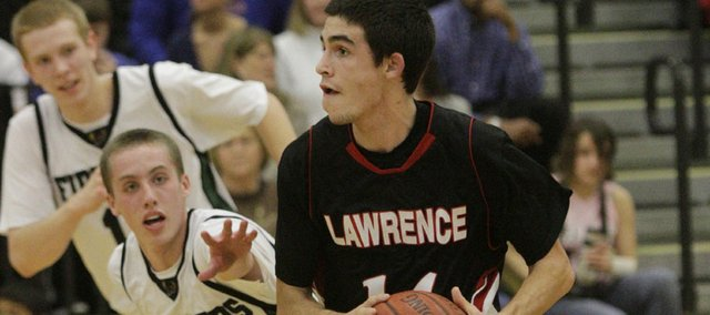 Lawrence High's KJ Pritchard looks for a shot at the buzzer against Free State on Friday, February 25, 2011 at Free State High School.