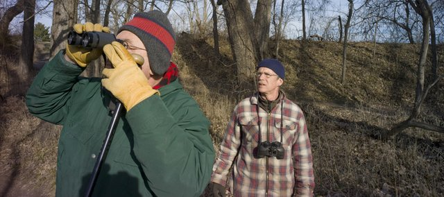 Jon Standing, left, and Bill Busby survey a wooded area for birds along the River Trail in North Lawrence near the Eighth Street boat ramp Saturday. The two took part in the annual winter bird count, which runs Dec. 14-Jan. 5.