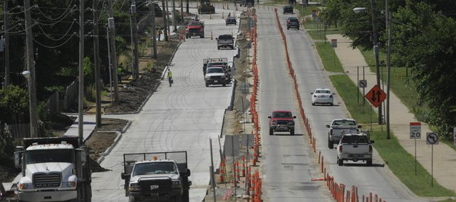 This file photo from June shows construction work on Kasold Drive. Lawrence City commissioners will meet Tuesday to request approval for a host of new road projects.