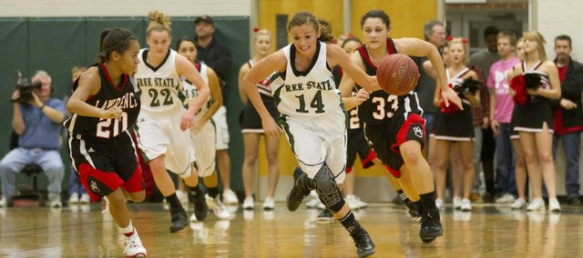 Free State's Lynn Robinson (14) beats Lawrence High defenders down the court after a turnover Friday, Dec. 16, 2011 at FSHS.