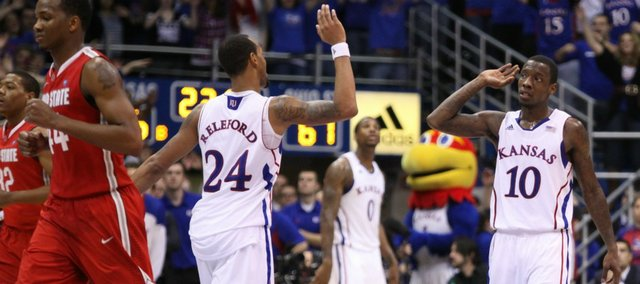 Kansas guards Tyshawn Taylor (10) and Travis Releford high-five as the Jayhawks wrap up the game against Ohio State in this photo from Dec. 10 at Allen Fieldhouse. The day after KU's 78-67 victory, Taylor underwent knee surgery.