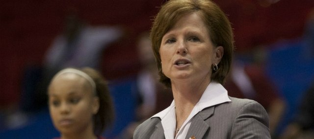 Kansas head coach Bonnie Henrickson motions to her team against IUPUI on Saturday, Nov. 26, 2011 at Allen Fieldhouse.