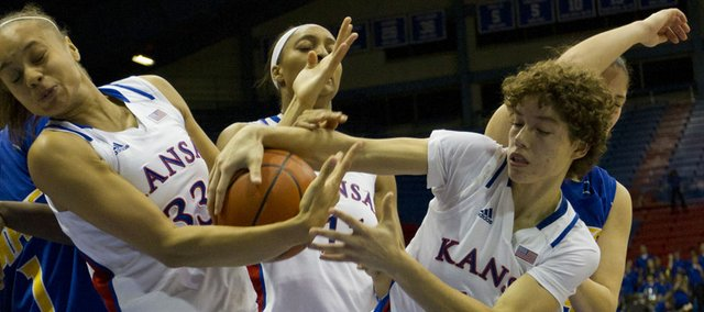 Kansas players Tania Jackson (33) and Monica Engelman, right, fight for a rebound during KU's game against UMKC on Saturday at Allen Fieldhouse.