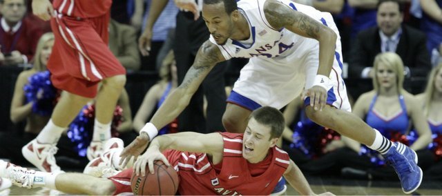 Kansas guard Travis Releford scrambles for a loose ball in the first half against Davidson on Monday, Dec. 19, 2011 at Sprint Center in Kansas City, Mo.