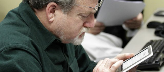 "Richard Wasserstrom takes a closer look at a Sony Pocket reader. The Lawrence Public Library recently held a ""technology petting zoo"" that offered a hands-on opportunity to try various e-readers."