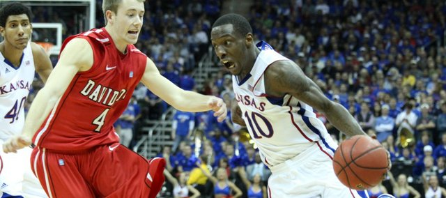 Tyshawn Taylor drives against Davidson in the second half Monday, Dec. 19, 2011 at Sprint Center in Kansas City, Mo.