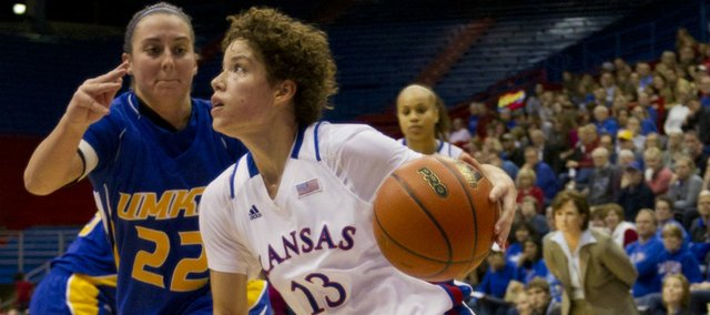 Kansas guard Monica Engelman drives the baseline against UMKC defender Brianna Eldridge during the Jayhawks' game on Saturday, Dec. 17, 2011 at Allen Fieldhouse.