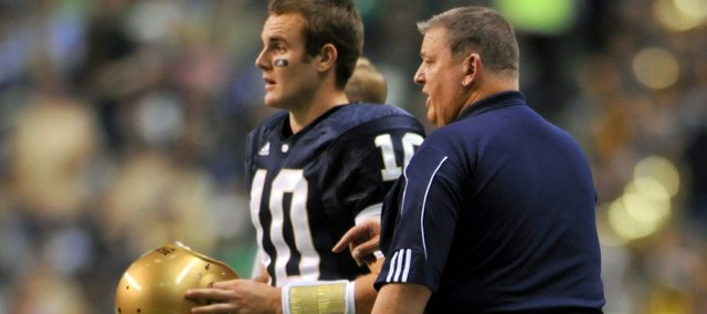 In this Oct. 31, 2009 file photo, Notre Dame head coach Charlie Weis puts in backup quarterback Dayne Crist against Washington State in the second half in San Antonio, Texas. Crist has decided to transfer to Kansas, where the former Notre Dame quarterback will be reunited with coach Weis.