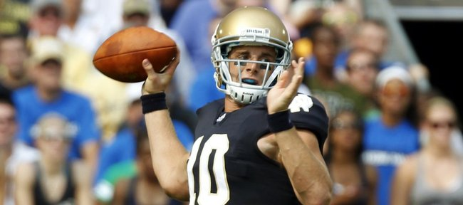 In this Sept. 3, 2011, file photo, Notre Dame quarterback Dayne Crist throws against South Florida in South Bend, Ind.