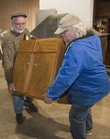 Sam Pepple, left, helps Byron James of Lawrence Habitat ReStore load a base cabinet Tuesday afternoon. KU&#39;s surplus program has delivered its 10,000th item to charity while helping to clear out old office furniture from various departments on campus.