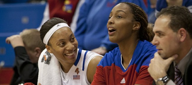 Kansas players Aishah Sutherland, left, and Carolyn Davis share a laugh on the bench during the closing minutes of Kansas' game against Oral Roberts Wednesday, Dec. 21, 2011 in Allen Fieldhouse.