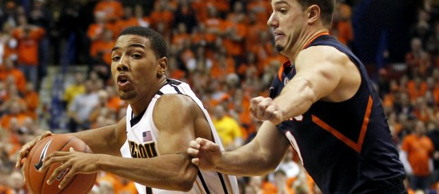 Missouri's Phil Pressey, left, heads to the basket past Illinois' Sam Maniscalco during the second half Thursday, Dec. 22, 2011, in St. Louis. Missouri won, 78-74.