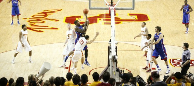 Kansas forward Thomas Robinson muscles his way in for a bucket against USC forward Aaron Fuller (21) during the second half. KU beat USC, 63-47, on Thursday, Dec. 22, 2011 in Los Angeles.