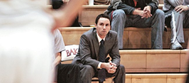 Baker University Head coach Brett Ballard Watches his team as it plays Evangel on Dec. 7 in Baldwin City. Ballard, a former Kansas University player and assistant for coach Bill Self, has coached Baker to a 9-3 start in his second year with the program.