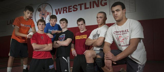 Lawrence High School has seven wrestlers ranked in the top five in the state this season in their weight classes. They are, from left: No. 2 Tristan Star, freshman; No. 3 Caden Lynch, junior;  No. 2 Hunter Haralson, junior; No. 3 Andrew Denning, junior; No. 3 Nick Pursel, senior; No. 1 Reece Wright-Conklin, senior;  No. 3 Brad Wilson, senior.