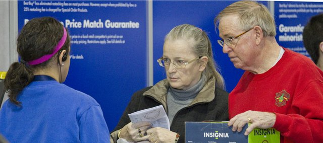 Cathie and Fred Pawlicki, right, stopped by Best Buy, 2020 W. 31st St., on Monday to exchange a Christmas gift they got for themselves that wasn't working properly. Exchanges and returns were big business on Monday but so were sales thanks to consumers spending gift cards and holiday cash.