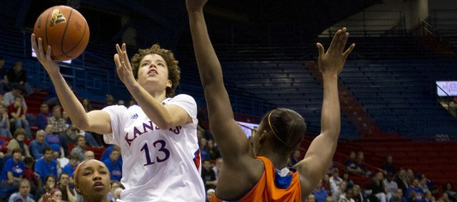 Kansas guard Monica Engelman (13) avoids defender Sequeena Thomas as she drives to the basket during KU's game against Sam Houston State on Wednesday, Dec. 28, 2011 in Allen Fieldhouse.