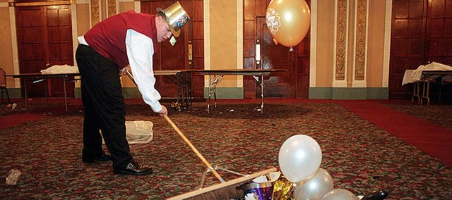 The risks of drunk driving are widely known, but drunk walking carries risks of its own. Experts urge New Year's Eve revelers to have a safe plan for getting home after the party ends. In this file photo, Sean Graves cleans up at the Eldridge Hotel after a New Year's Eve party.