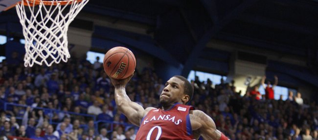 Kansas forward Thomas Robinson pulls back for a dunk off a breakaway against North Dakota during the second half on Saturday, Dec. 31, 2011 at Allen Fieldhouse.