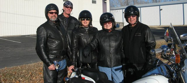 Motorcycle riders from Kansas City enjoy the unseasonably warm weather. Pictured from left are: Scott Sturdeuant, Alec Todd, Donna McGren, Shari Crisman and Gar Crisman.
