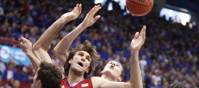 Kansas center Jeff Withey fights for a loose ball amidst the North Dakota defense during the first half Saturday, Dec. 31, 2011 at Allen Fieldhouse.