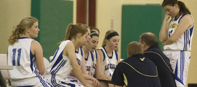 Veritas huddles during a timeout against Topeka Cornerstone on Tuesday, Jan. 3, 2012 in Eudora.