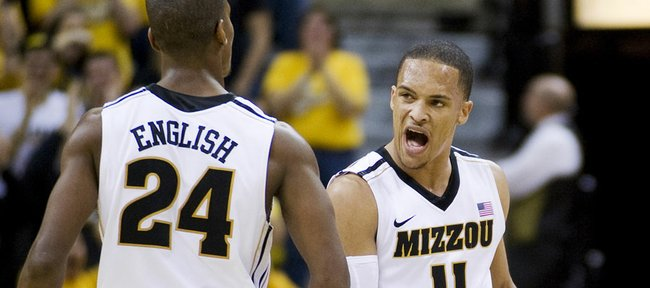 Missouri's Michael Dixon, right, celebrates with teammate Kim English during the second against Oklahoma Tuesday, Jan. 3, 2012, in Columbia, Mo. Missouri won the game 87-48.