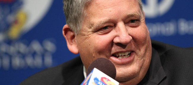 Charlie Weis laughs with media members during a news conference on Friday.