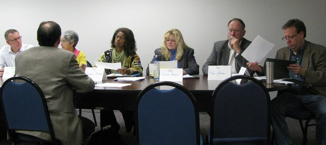 Douglas County legislators on Thursday met with representatives of area organizations to talk about issues in upcoming legislative session. From left to right, facing forward, are state Rep. Paul Davis, D-Lawrence, state Sen. Marci Francisco, D-Lawrence, state Rep. Barbara Ballard, D-Lawrence, state Rep. TerriLois Gregory, R-Baldwin City, state Rep. Tom Sloan, R-Lawrence, and state Sen. Tom Holland, D-Baldwin City. They were speaking with Steve Solomon of The Farm — Douglas County Visitation Center. The legislators met with officials from more than a dozen organizations during a meeting at the Lawrence school district headquarters.