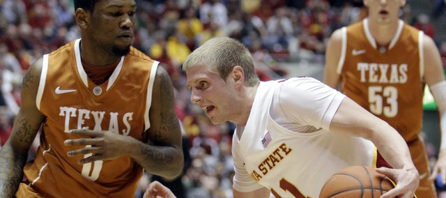 Iowa State guard Scott Christopherson (11) looks to drive past Texas guard Julien Lewis, left, during the first half Wednesday, Jan. 4, 2012, in Ames, Iowa.