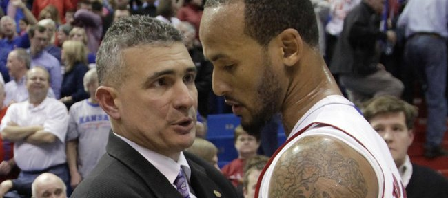 Kansas State coach Frank Martin greets KU's Travis Releford at the end of the Jayhawks 67-49 win against Kansas State at Allen Fieldhouse, Wednesday, Jan. 4, 2012.