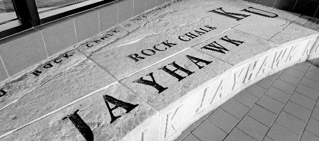 "The Rock Chalk chant is inscribed on a stone bench in the Kansas Union at Kansas University. A group of about 350 has formed to rally against fans shouting ""Woo!"" at the end of the chant. The anti-woo group has taken a few actions to preserve the chant in its original form. Larry Tenopir, a Topeka attorney, wrote a letter to the University Daily Kansan last semester arguing that the chant stands out because it's so different from everyone else's."
