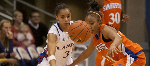 Kansas guard Angel Goodrich disrupts Sam Houston State's Khamra Echols by knocking the ball away during Wednesday's game at Allen Fieldhouse.