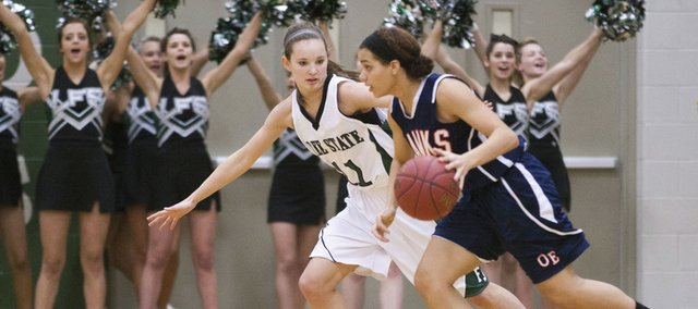 Free State's Kennedy Kirkpatrick (11) defends Olathe East's Justice Daniel on Friday, Jan. 6, 2012, at FSHS.