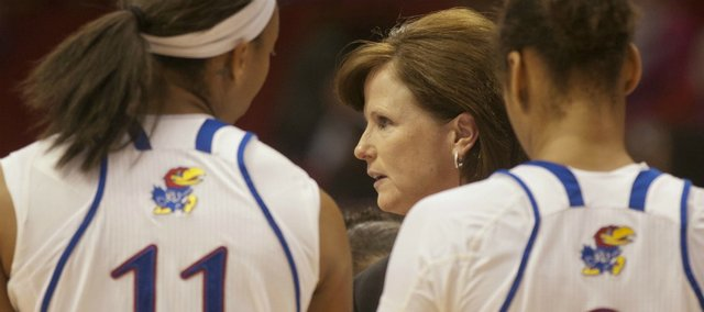 Kansas head coach Bonnie Henrickson addresses her players against Sam Houston State on Wednesday, Dec. 28, 2011, at Allen Fieldhouse.