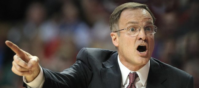 Oklahoma head coach Lon Kruger protests a call in the first half against Kansas on Saturday, Jan. 7, 2012, at Lloyd Noble Center.