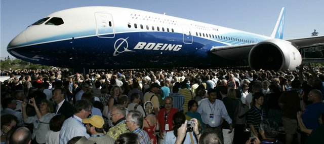 The first production model of the new Boeing 787 Dreamliner airplane is unveiled to an audience of several thousand employees, airline executives, and dignitaries during a ceremony at Boeing's assembly plant in Everett, Wash., in this 2007 file photos. Kansas leaders are insisting that Wichita still will be able to define itself as the aircraft manufacturing capital of the world even without the Boeing plant, which announced it will close this month. Gov. Sam Brownback is promising aggressive attempts to attract new commercial aviation work — even mentioning Boeing rival Airbus.