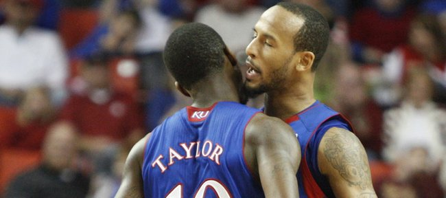 Kansas guard Travis Releford gets a chest bump from teammate Tyshawn Taylor during the second half Saturday, Jan. 7, 2012, at Lloyd Noble Center.
