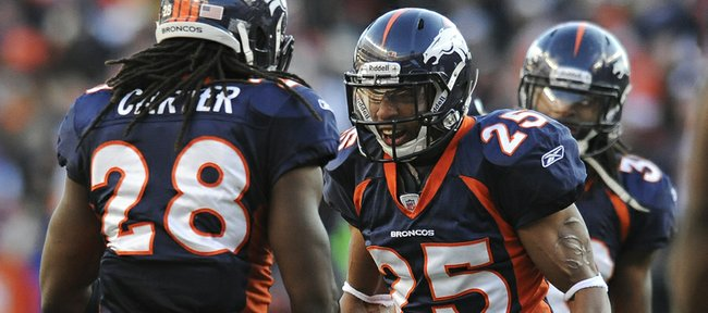 Denver Broncos strong safety Chris Harris (25) celebrates with free safety Quinton Carter after Carter intercepted a pass by Pittsburgh quarterback Ben Roethlisberger in the second quarter of their NFL wild-card playoff game Sunday in Denver. The Broncos won in overtime, leaving Harris  a Kansas University product  on one of just eight teams still alive.