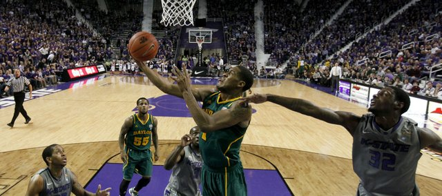 Baylor's Perry Jones III (1) puts up a shot under pressure from Kansas State forward Jamar Samuels (32) during the first half Tuesday, Jan. 10, 2012, in Manhattan, Kan.