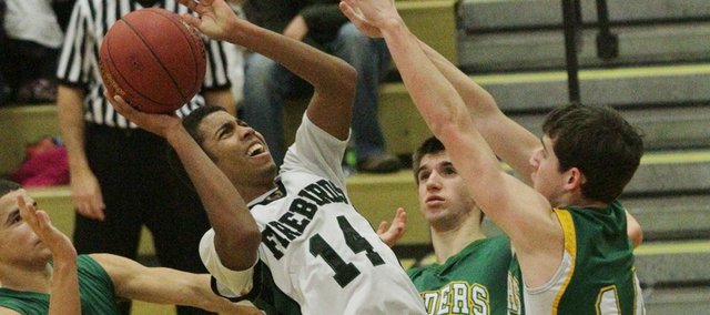 Free State&#39;s Cameron Dabney grabs a rebound against Shawnee Mission South on Tuesday, Jan. 10, 2012, at FSHS.