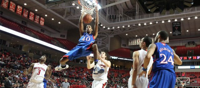 Kansas forward Kevin Young elevates for a dunk on the Texas Tech defense late in the first half Wednesday, Jan. 11, 2012, at United Spirit Arena.