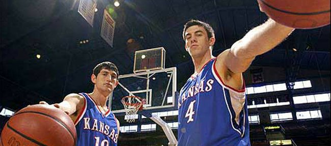 Former Kansas basketball players Kirk Hinrich, left, and Nick Collison were a part of the 2002 Final Four team that went 33-4 overall and 16-0 in Big 12 play.