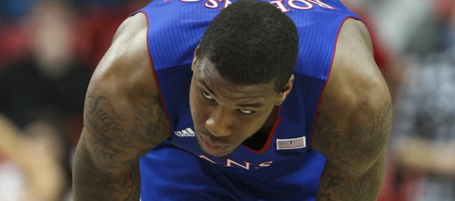 Kansas forward Thomas Robinson stretches out while awaiting a couple of Jayhawk free throws after a technical foul against Texas Tech during the first half Wednesday, Jan. 11, 2012, at United Spirit Arena.