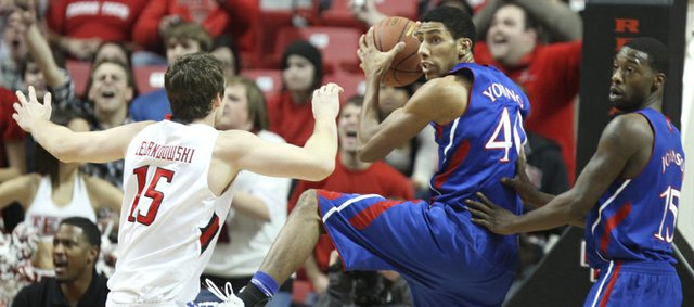 Kansas forward Kevin Young is supported by teammate Elijah Johnson as he comes down with a rebound before Texas Tech center Robert Lewandowski during the first half on Wednesday, Jan. 11, 2012 at United Spirit Arena.
