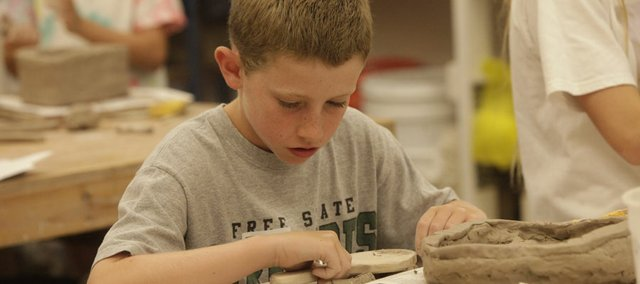 Jacob Gillespie, 12, shapes a clay vessel at the Lawrence Arts Center in a Sculpting with Clay class in this Aug. 2011 file photo. Gov. Sam Brownback on Thursday proposed providing $200,000 for the arts, but arts supporters said the measure was inadequate and didn't make up for his veto of arts funding last year.