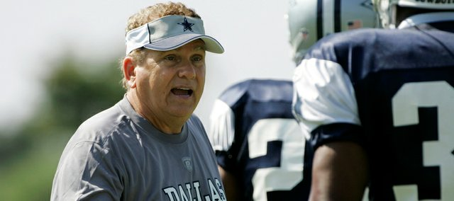 In this file photo from July 27, 2008, former Dallas Cowboys secondary coach Dave Campo organizes drills during Cowboys training camp in Oxnard, Calif. Kansas University announced on Friday that Campo will serve as defensive coordinator under new KU coach Charlie Weis.