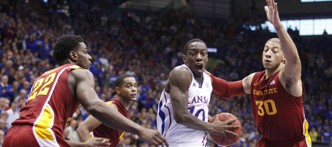 Kansas guard Tyshawn Taylor drives between Iowa State defenders Anthony Booker (22), Chris Allen (4) and Royce White (30) during the first half on Saturday, Jan. 14, 2012 at Allen Fieldhouse.