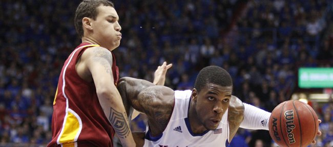 Kansas forward Thomas Robinson drives against Iowa State center Jordan Railey during the second half on Saturday, Jan. 14, 2012 at Allen Fieldhouse.