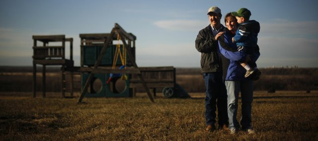 LaVell Winsor is pictured with her husband, Andy Winsor, and their 1-year-old son, Brayden, on Friday on their farm outside of Grantville. LaVell is one of several women in the state who participate in CommonGround, a woman-to-woman group that works to dispel misconceptions about farming. Winsor would like others to understand her belief that the overwhelming majority of farming in the country is done by family operations rather than corporations.